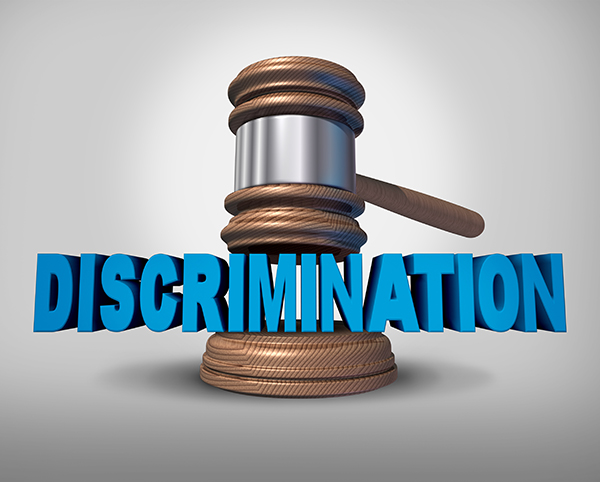 gavel with discrimination text