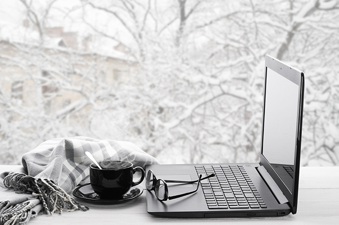 winter day with laptop by window